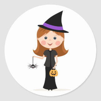 Little girl with spider dressed up as a witch classic round sticker