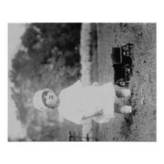 Little Girl with Toy Wagon Photograph Posters