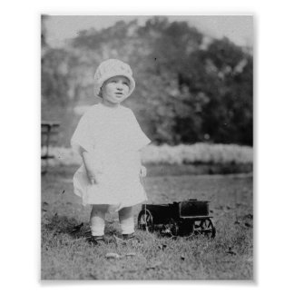 Little Girl with Toy Wagon Posters