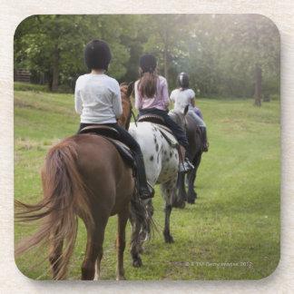 Little girls riding horses beverage coaster