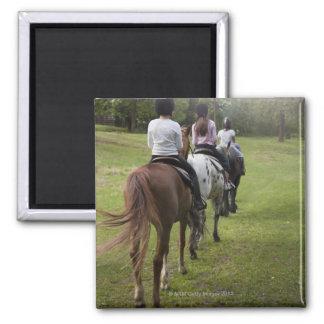 Little girls riding horses magnet