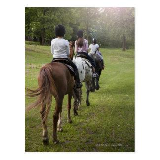 Little girls riding horses postcard