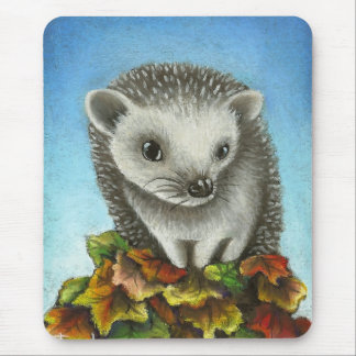 Little hedgehog on a big pile of leaves mouse pad