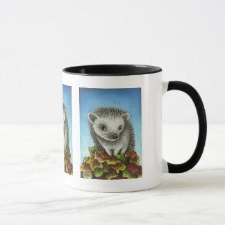 Little hedgehog on a big pile of leaves mug