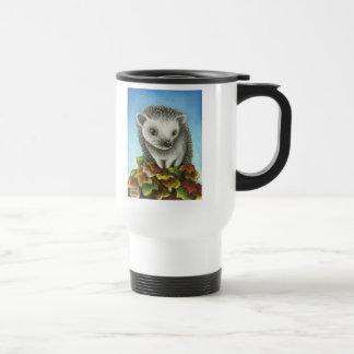 Little hedgehog on a big pile of leaves travel mug