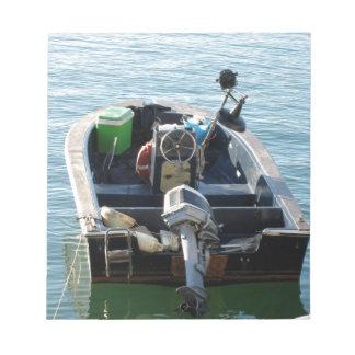 Little italian fishing boat on the sea notepad