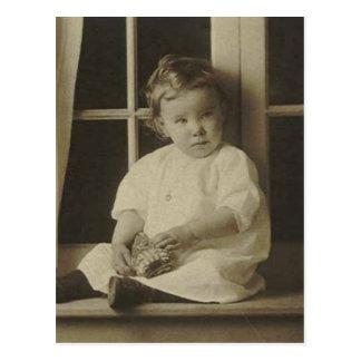 Little kid holding stuffed toy postcards