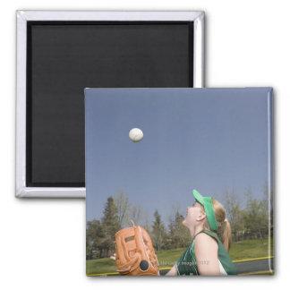 Little league player catching ball magnet