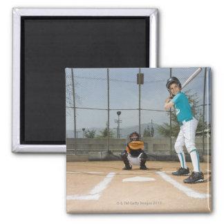 Little league player up to bat magnet