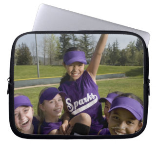 Little league players carrying teammate computer sleeve