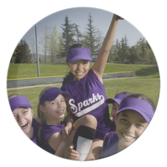 Little league players carrying teammate melamine plate