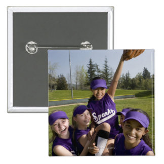 Little league players carrying teammate pinback button