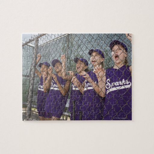 Little league team cheering in dugout jigsaw puzzle