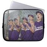 Little league team cheering in dugout laptop sleeve