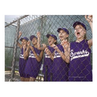 Little league team cheering in dugout postcard