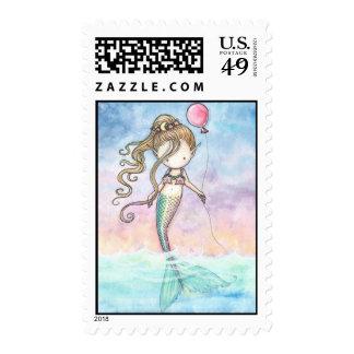 Little mermaid con los sellos del globo