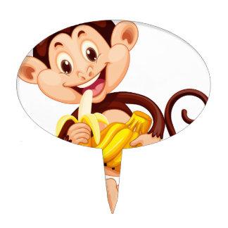 Little monkey eating banana cake topper