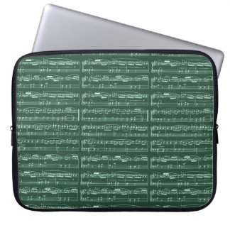 little musical notes on green laptop sleeve
