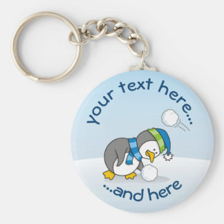 Little penguin getting a snow ball keychain