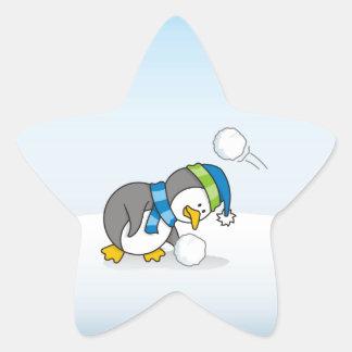 Little penguin getting a snow ball star sticker