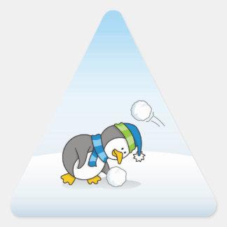 Little penguin getting a snow ball triangle sticker