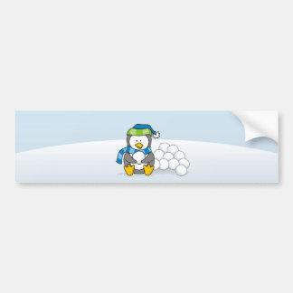 Little penguin sitting with snowballs bumper sticker