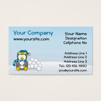 Little penguin sitting with snowballs business card