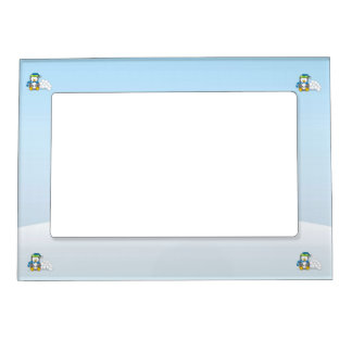 Little penguin sitting with snowballs magnetic picture frame