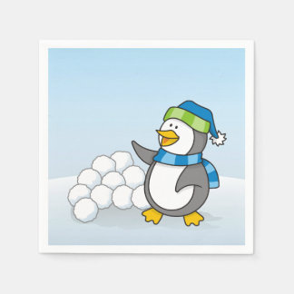 Little penguin with snow balls waving napkin