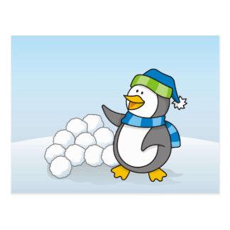 Little penguin with snow balls waving postcard
