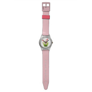 Little pink pig in grass watches