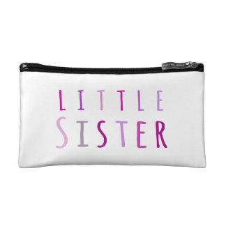 Little sister in pink makeup bag