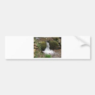 Little waterfall by mossy rocks in the forest bumper sticker