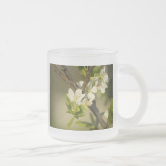 Little white flowers on a branch with green leafs frosted glass coffee mug
