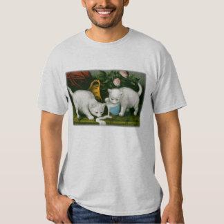 little white kitties getting into mischief milk shirts