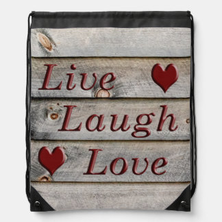 Live Laugh Love on the side of a barn Drawstring Backpack