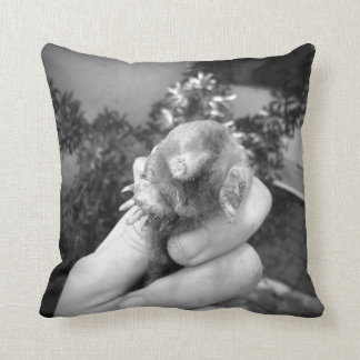 Live mole in hand smiling animal black white pillow