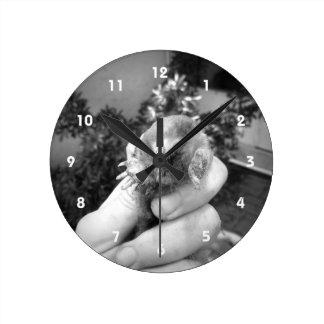 Live mole in hand smiling animal black white round clock