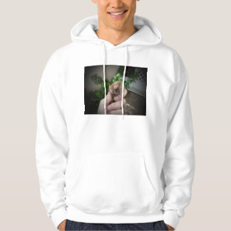 Live mole in hand smiling.jpg hooded pullover