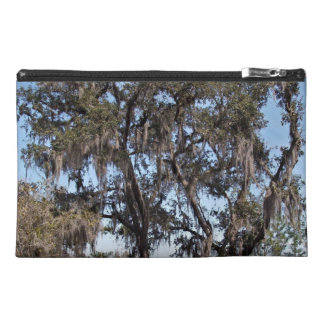 Live oak tree in river banks against the blue sky travel accessory bag