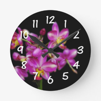 Living Room - Purple orchids on Black background Round Clock