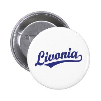 Livonia script logo in blue button