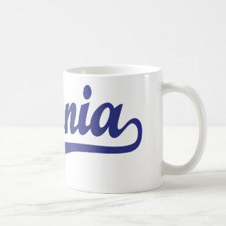 Livonia script logo in blue mugs