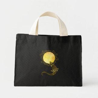 Lizard Holding the Spiral Sun Mini Tote Bag