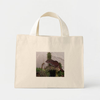 Lizards on cactus against pale yellow background mini tote bag