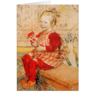 Lizbeth que sostiene una muñeca tarjeta de felicitación