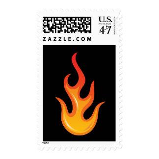 Llama caliente llameante del fuego en sello negro