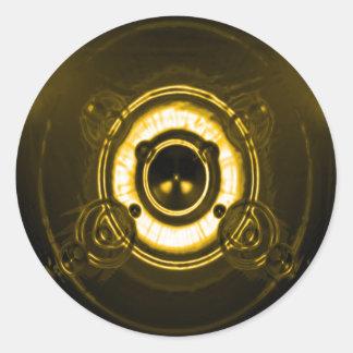 Llamarada de la lente del oro pegatina redonda