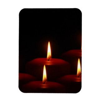 Llamas de vela del advenimiento del día de fiesta  imanes
