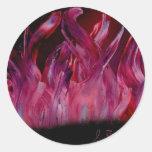 Llamas púrpuras y negras en pintura de aerosol pegatina redonda